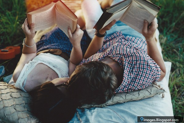 kissing-cute-couple-during-reading-book